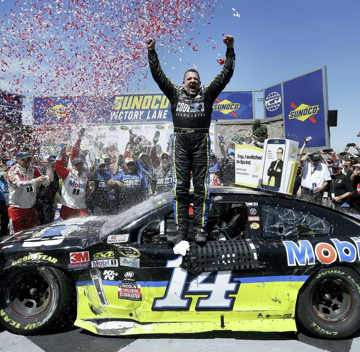 Tony Stewart celebrates after winning Sunday in Sonoma, Calif.