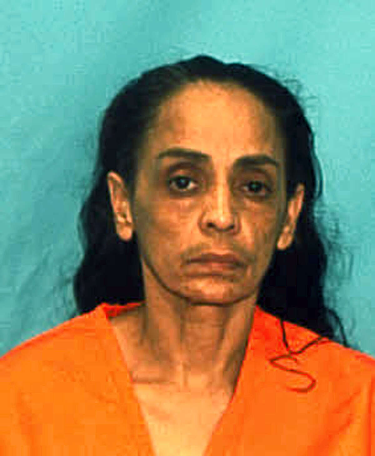 """In this undated arrest photo made available by the Florida Department of Law Enforcement shows Ana Maria Cardona. The murder conviction and death sentence imposed on Cardona for killing her young son known as """"Baby Lollipops"""" in 1990, have been thrown out by the state Supreme Court in Tallahassee, Fla., Thursday, Feb. 18, 2016. The decision means that Cardona is likely to face a new trial."""
