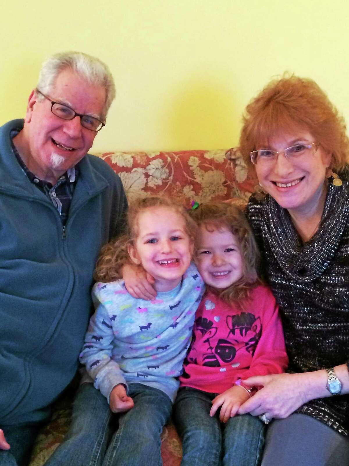 Joel and Barbara Levitt with grandchildren Haley and Briella Bittner.