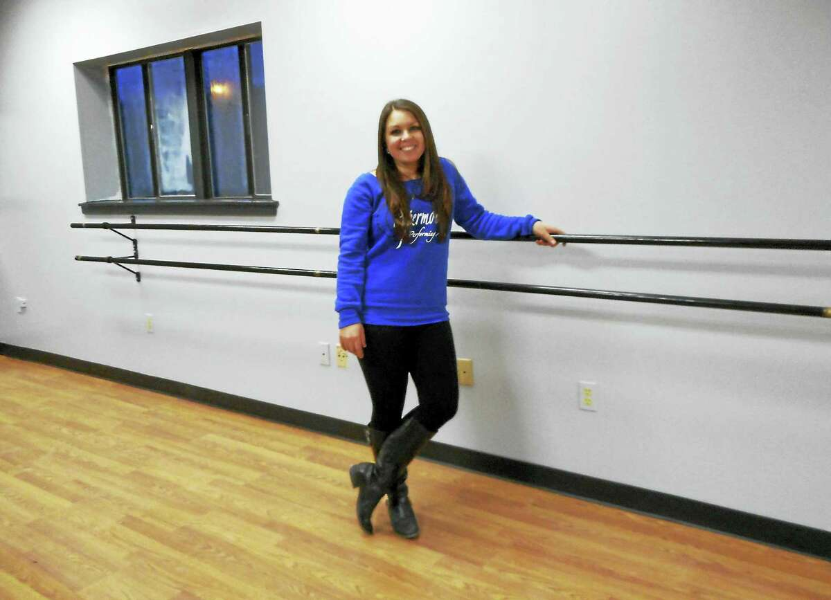Catherine Guarnieri — Register CitizenDanielle Eichmann, owner of Papermoon Performing Arts poses at the barre of her new practice room at 1447 New Litchfield St. in Torrington.