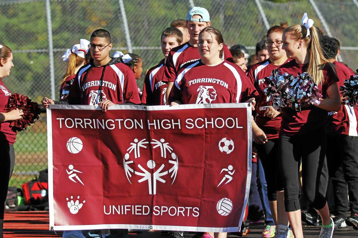 Members of the Torrington High School Unified Sports walk out before the start of the soccer championship Thursday afternoon.