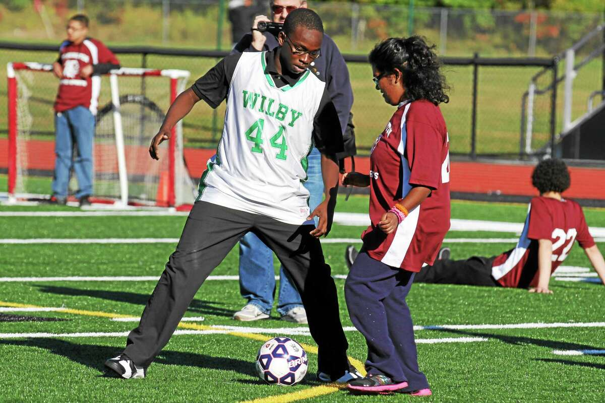 Players from Wilby and Torrington look to control the ball during the NVL Unified Sports Championship Thursday afternoon.