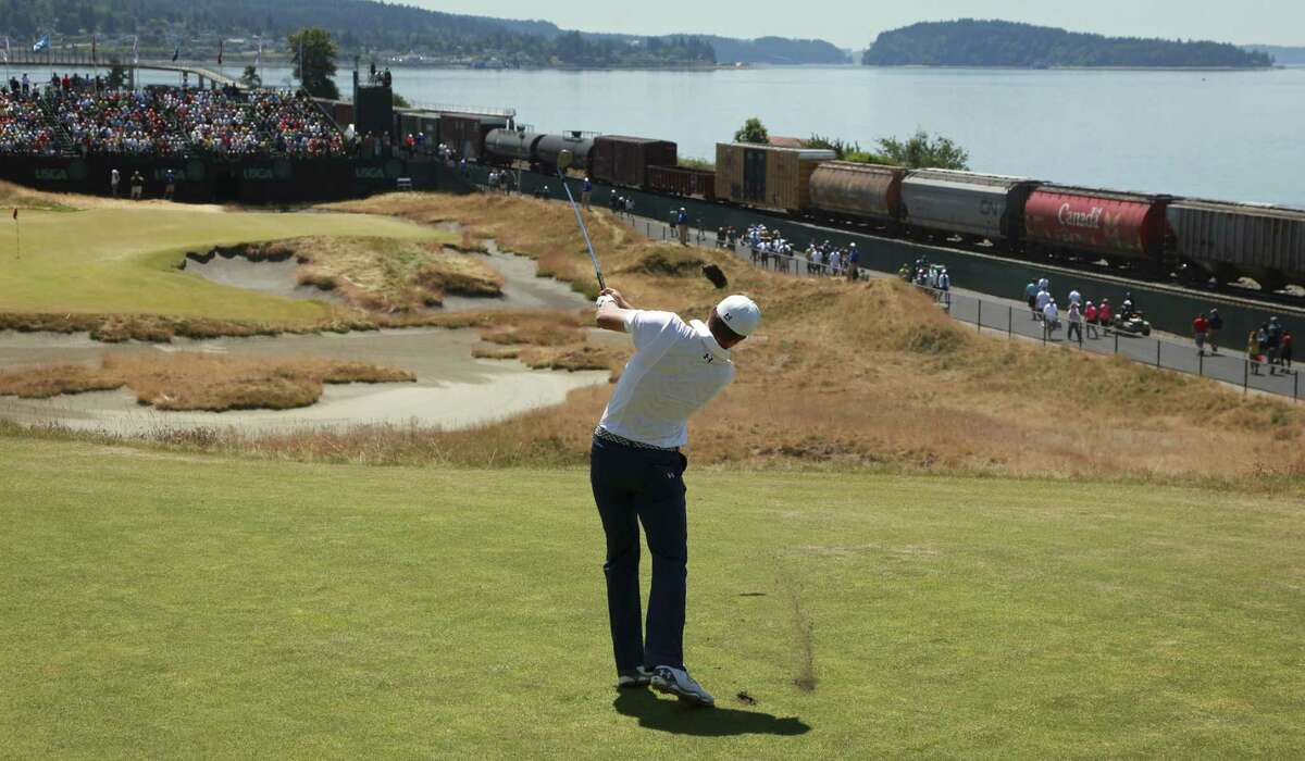 Jordan Spieth watches his tee shot on the 16th hole during a practice round for the U.S. Open Wednesday at Chambers Bay in University Place, Wash.