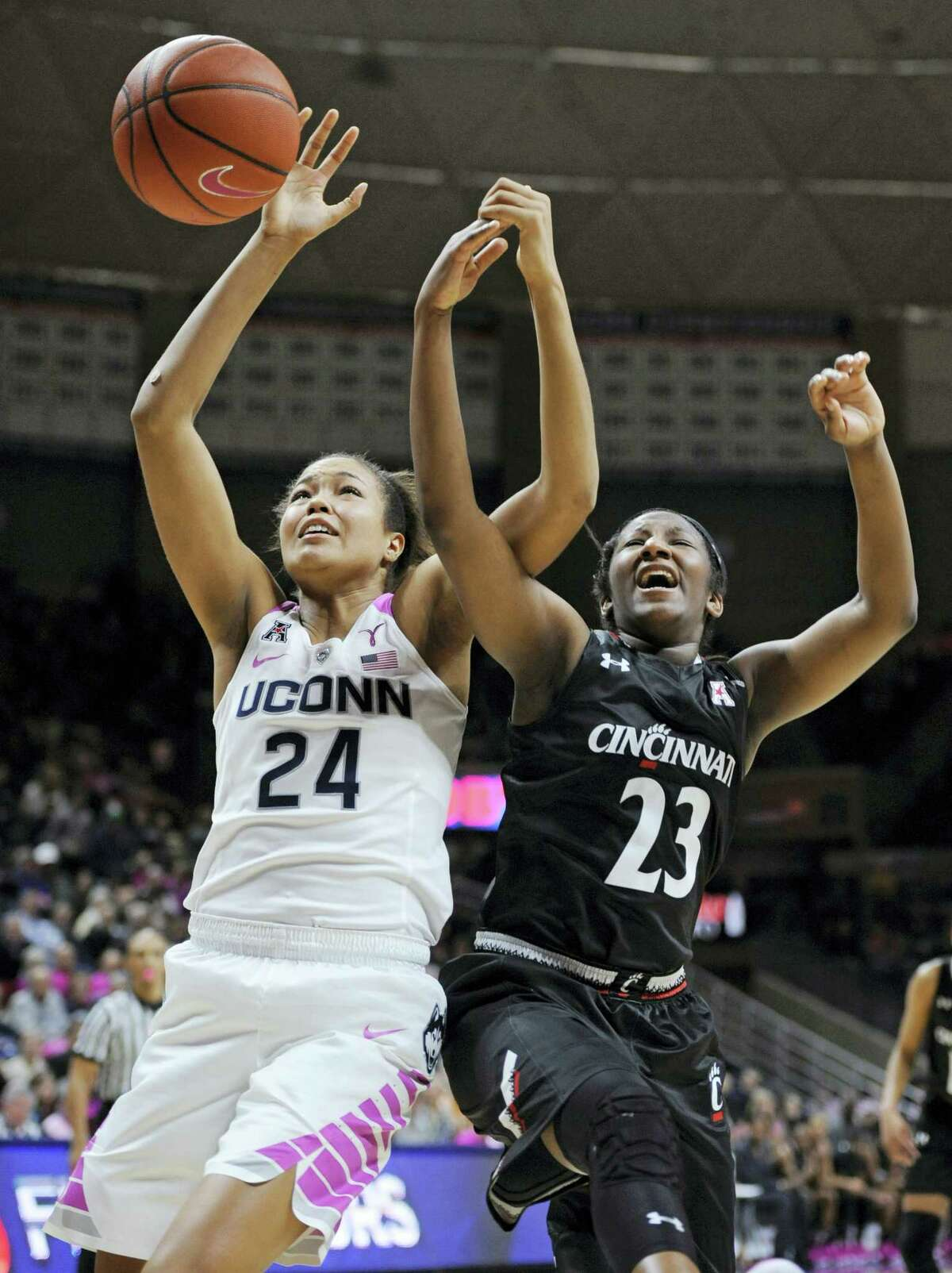 UConn's Napheesa Collier, left, and Cincinnati's Jasmine Whitfield reach for a rebound during the first half Wednesday in Storrs.