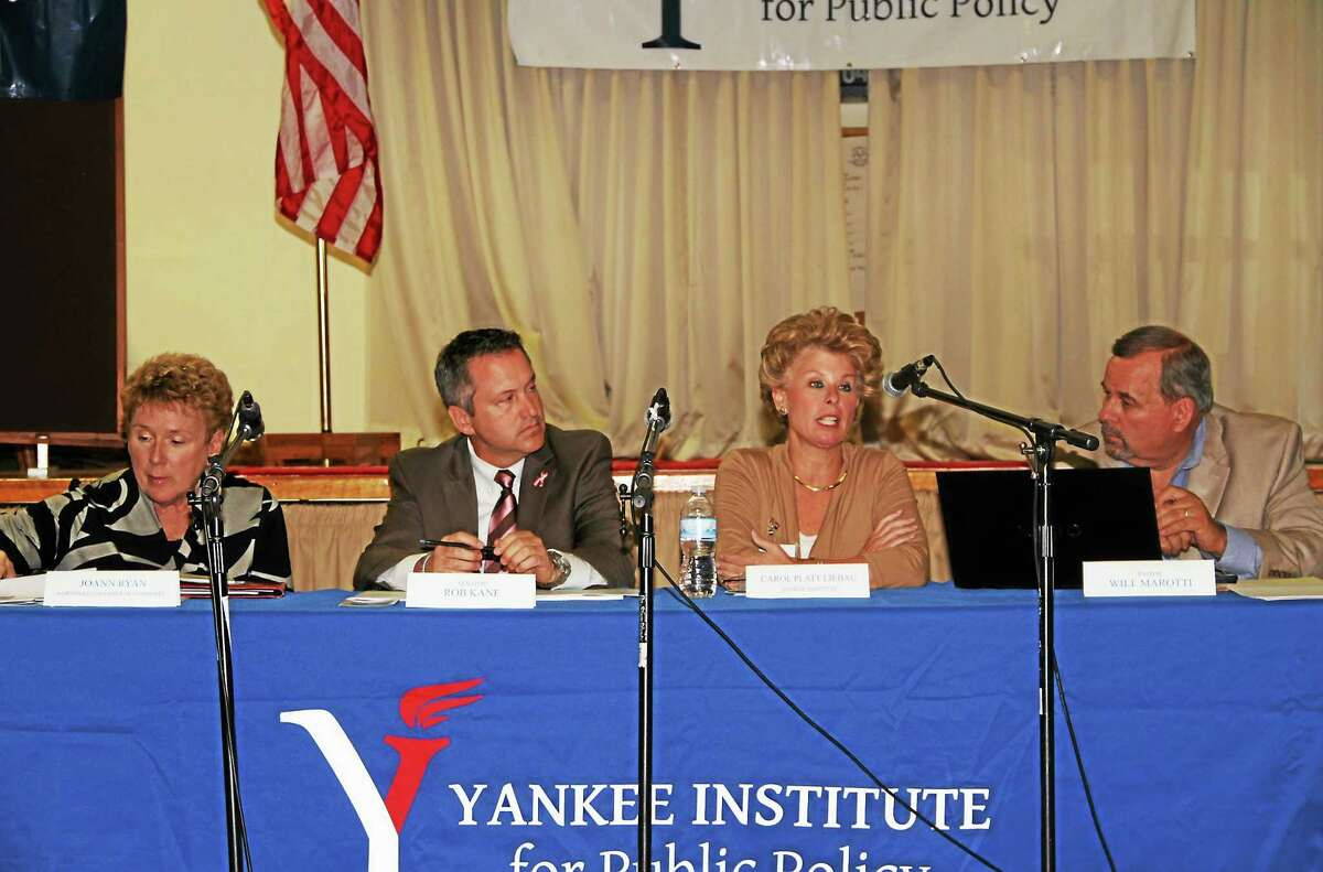 """The Yankee Institute for Public Policy took its """"The Shirt Off My Back"""" tour to Torrington Wednesday night to discuss taxes and the high cost of doing business in Connecticut. The panel of speakers, from left, included JoAnn Ryan, of the Northwest Chamber of Commerce; state Sen. Rob Kane, R-Watertown; Carol Platt Liebau, president and chief executive officer of the Yankee Institute; and moderator Pastor Will Marotti."""