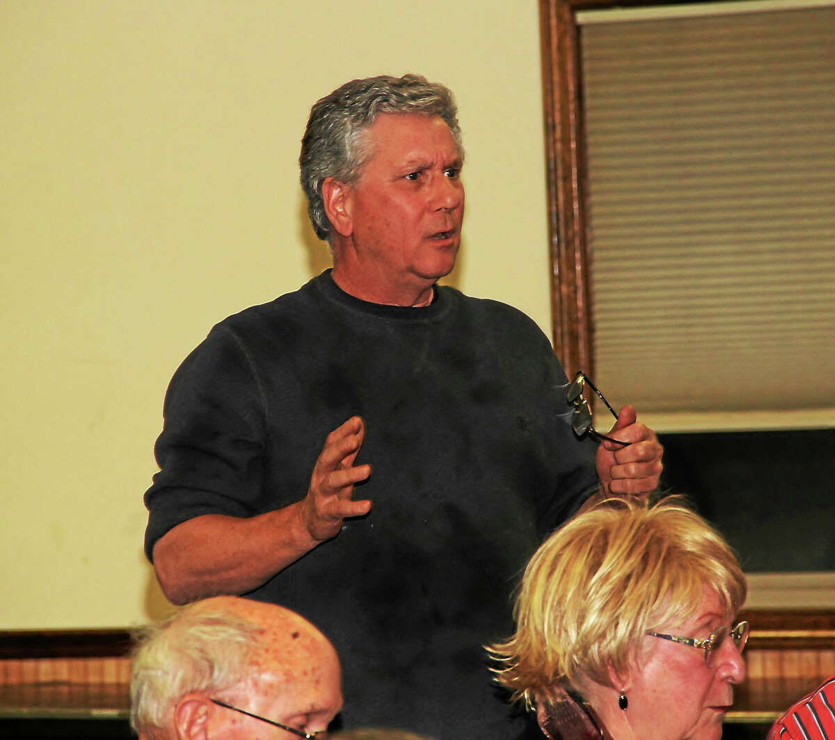 """Gary Nalband, of Litchfield, owner of Mirror Polishing Plating in Waterbury, addresses the panel during the """"The Shirt Off My Back"""" discussion on taxes and the high cost of doing business in Connecticut. The event was held Wednesday night at the Knights of Columbus Hall in Torrington."""