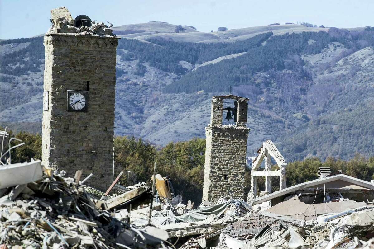 A view of the town of Amatrice, with the bell tower visible at left, after an earthquake with a preliminary magnitude of 6.6 struck central Italy on Oct. 30, 2016. A powerful earthquake rocked the same area of central and southern Italy hit by quake in August and a pair of aftershocks last week, sending already quake-damaged buildings crumbling after a week of temblors that have left thousands homeless.