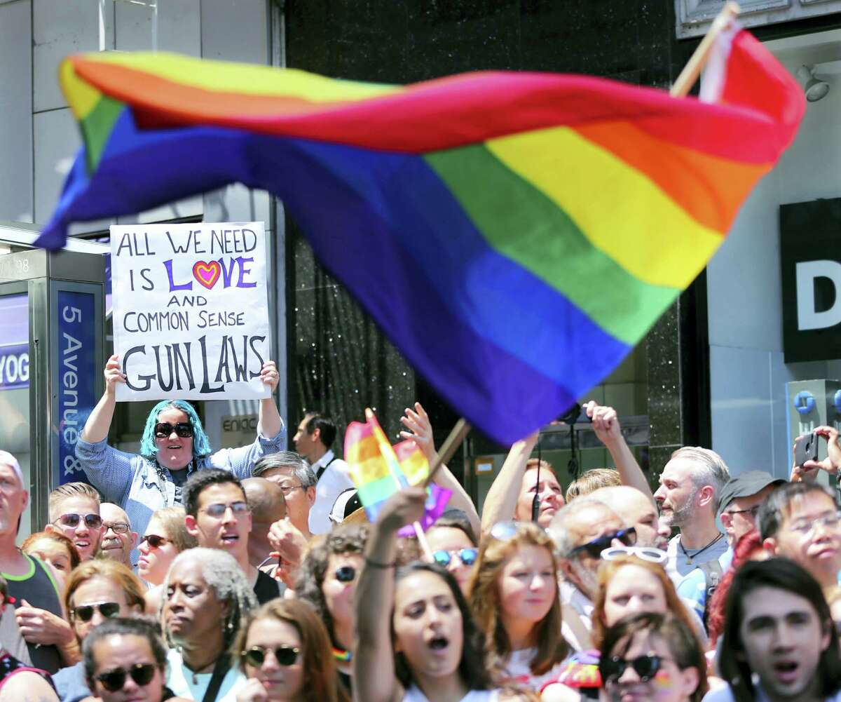 Parade-goers shout, wave flags and hold signs during the New York City Pride Parade Sunday, June 26, 2016 in New York City.