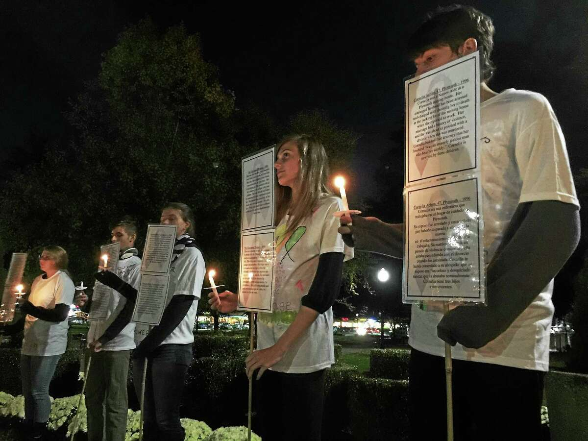 Members of the Thomaston High School Interact Club serve as live silent witnesses as part of the 27th annual candlelight vigil organized by the Susan B. Anthony Project Wednesday in Torrington.