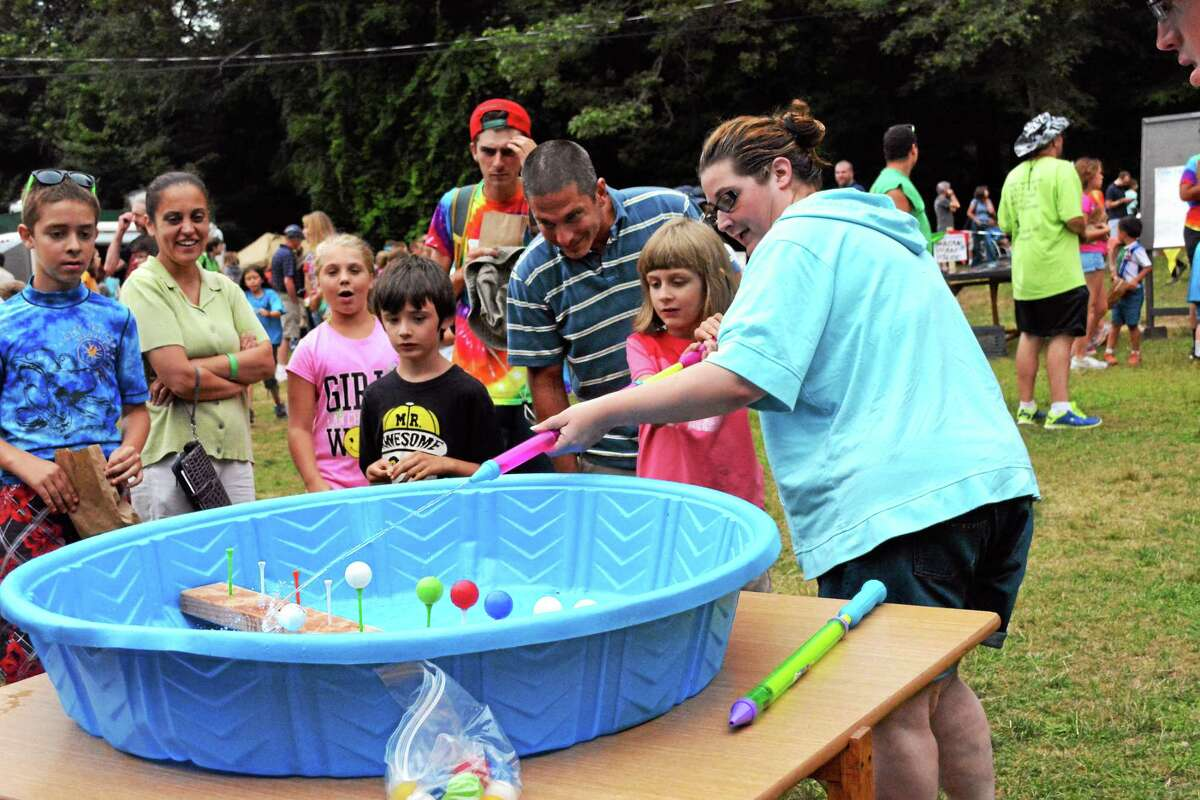 Children participated in a variety of activities at the Camp Moe Day carnival in Torrington in this Aug. 1, 2014, file photo.