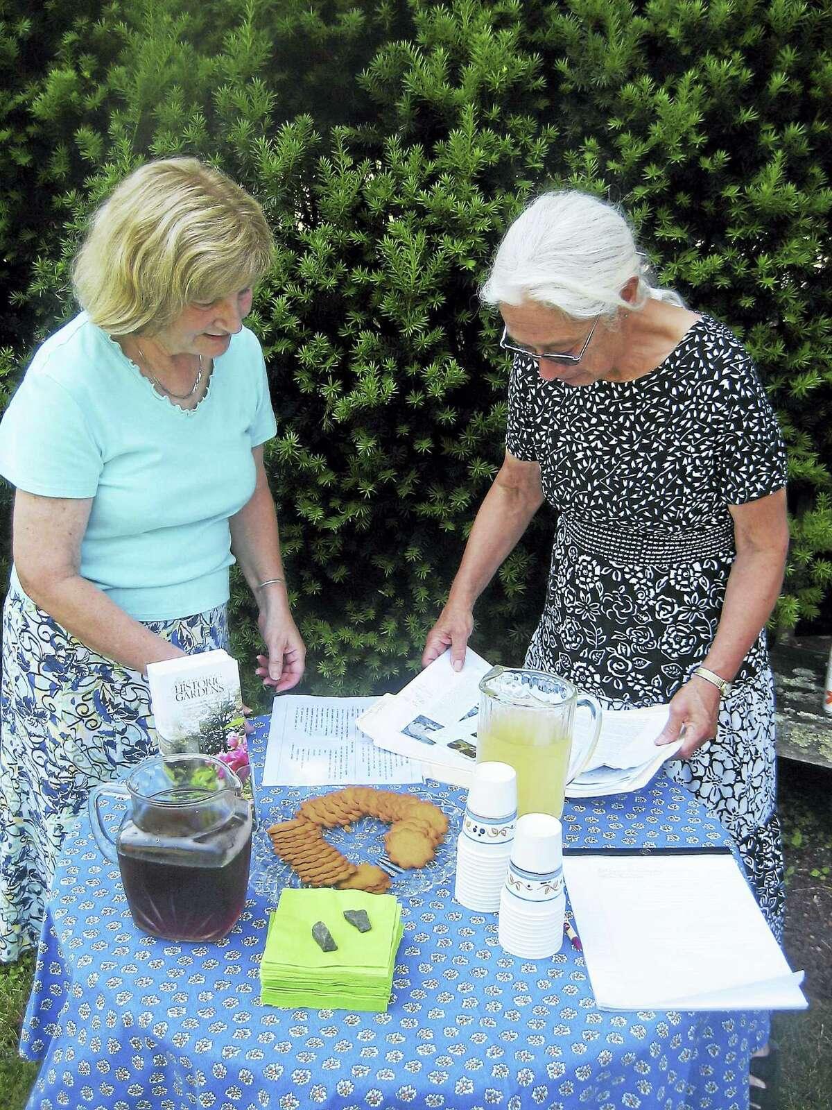 John Torsiello photo Volunteers Debbie Soresino and Priscilla Price get snacks and drinks ready.