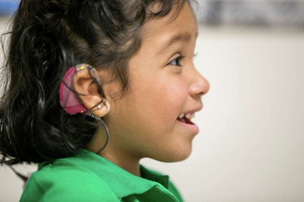 In this Feb. 11, 2015 photo, Angelica Lopez, 3, smiles during a therapy session at the University of Southern California in Los Angeles. Angelica was born deaf and received an auditory brainstem implant to allow her to hear some sounds in a research study at the USC.