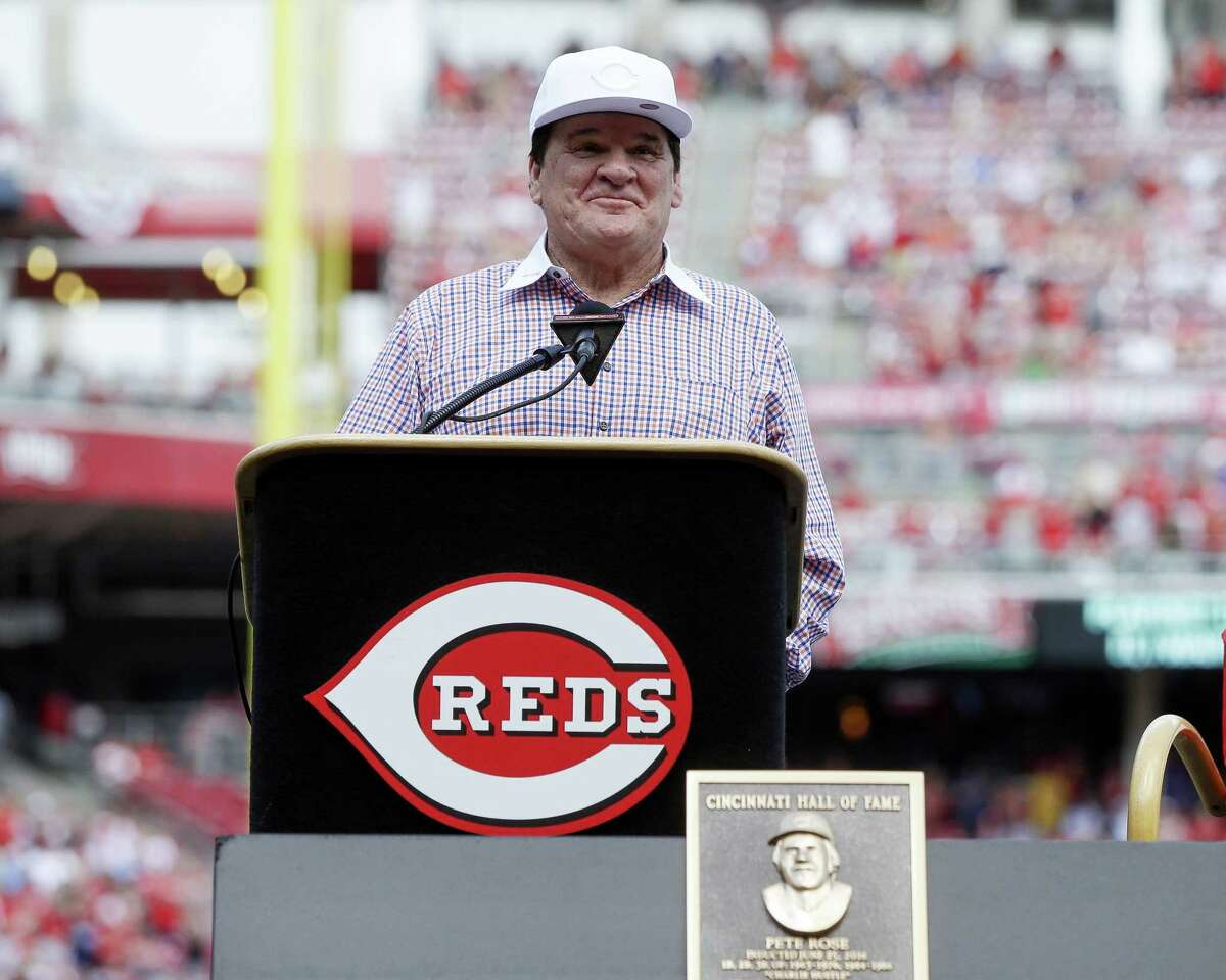 Former Cincinnati Reds player and manager Pete Rose speaks during a ceremony as he is inducted into the Cincinnati Reds Hall of Fame before Saturday's game against the Padres in Cincinnati.