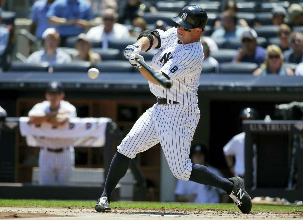 Brett Gardner hits a single during the first inning on Saturday.