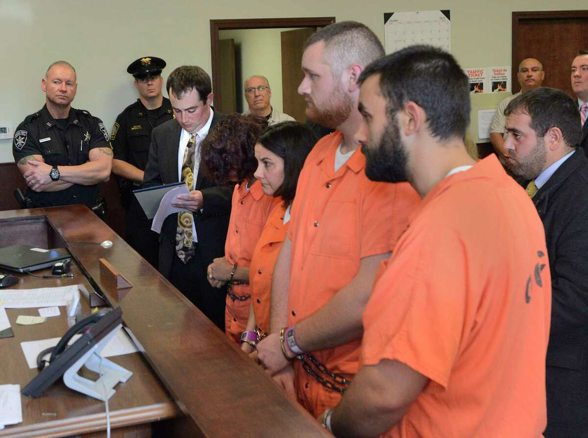 From left, Sarah Ferguson, 33, Linda Morey, 54, Joseph Irwin, 26, and David Morey, 26, are arraigned in front of Judge Bill M. Virkler after being charged with second-degree assault of 17-year-old Christopher T. Leonard, Teusday, Oct. 13, 2015, in New Hartford, N.Y. A central New York couple have been charged with fatally beating their 19-year-old son Lucas Leonard inside a church, and the four fellow church members have been charged with assault in an attack that also left the young man's brother Christopher severely injured, police said Tuesday.