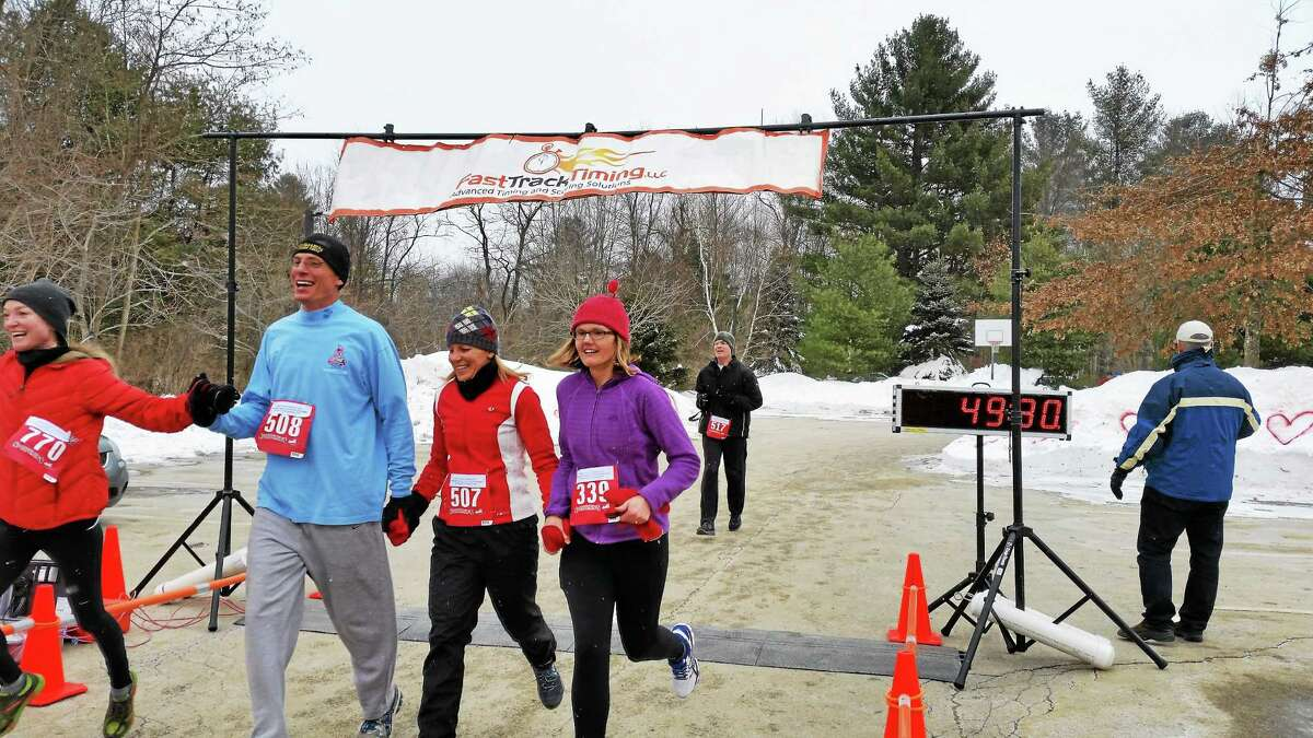 Three hundred runners and walkers compete on a five-mile run/three-mile walk at the 13th Annual Bob & Peg Andrulis Memorial Sweetheart Run & Walk held on Valentine's Day on Saturday at the Litchfield Community Center at 421 Bantam Road in Litchfield. The race raised approximately $7,750 for the Community Center's family programs.