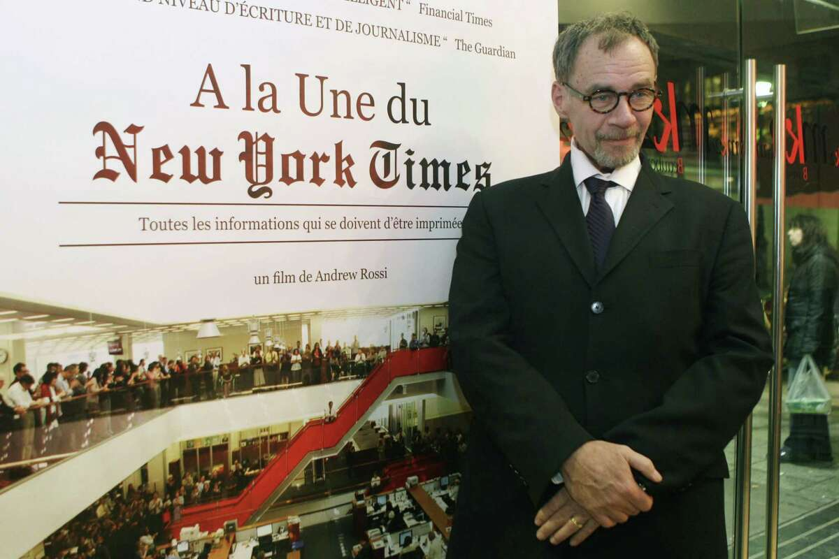 """In this Nov. 21, 2011 photo, New York Times journalist David Carr poses for a photograph as he arrives for the French premiere of the documentary """"Page One: A Year Inside The New York Times,"""" in Paris. Carr collapsed at the office and died in a hospital on Feb. 12, 2015."""