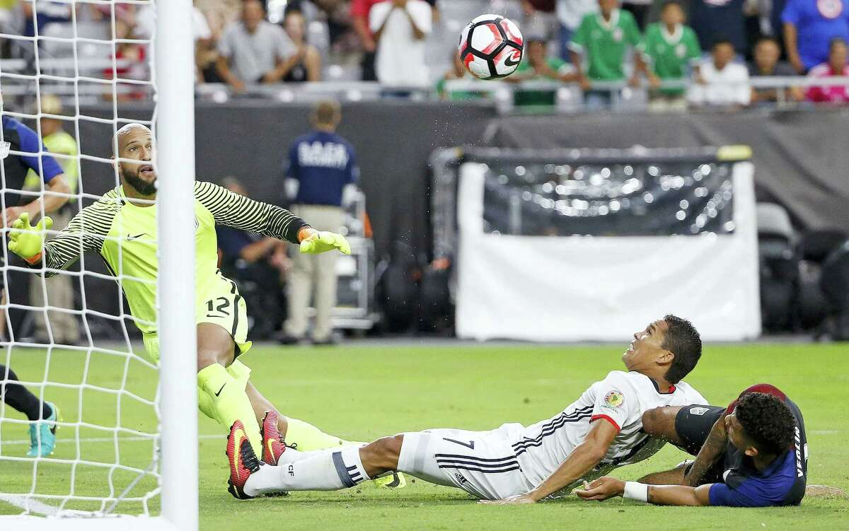 Colombia's Carlos Bacca sends the ball past U.S. goalie Tim Howard for a goal on Saturday.