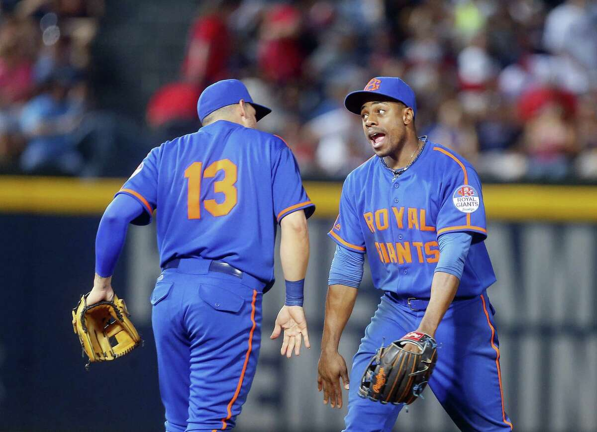 The Mets' Asdrubal Cabrera, left, and Curtis Granderson celebrate after defeating the Braves on Saturday.
