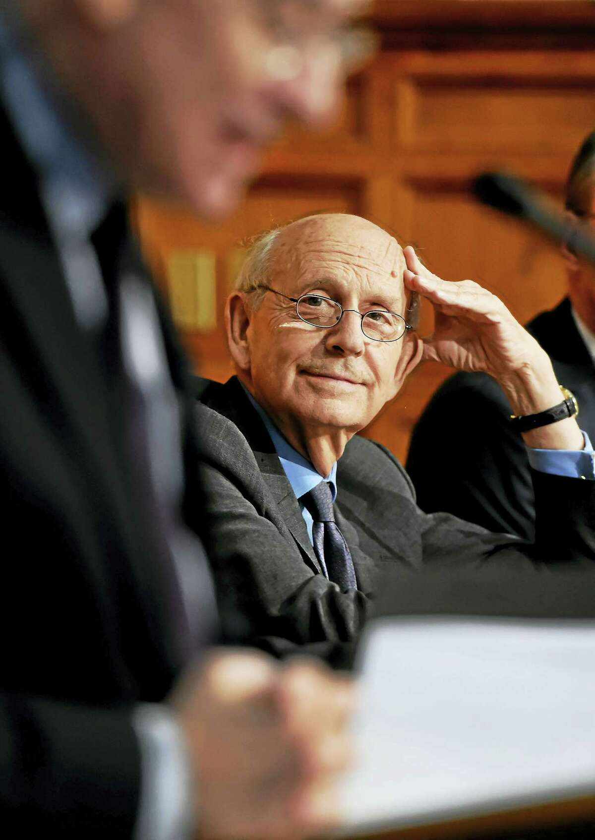 Supreme Court Justice Stephen Breyer, right, listens to Yale Law School Dean Robert Post, before speaking at the Yale Law School in New Haven Wednesday.