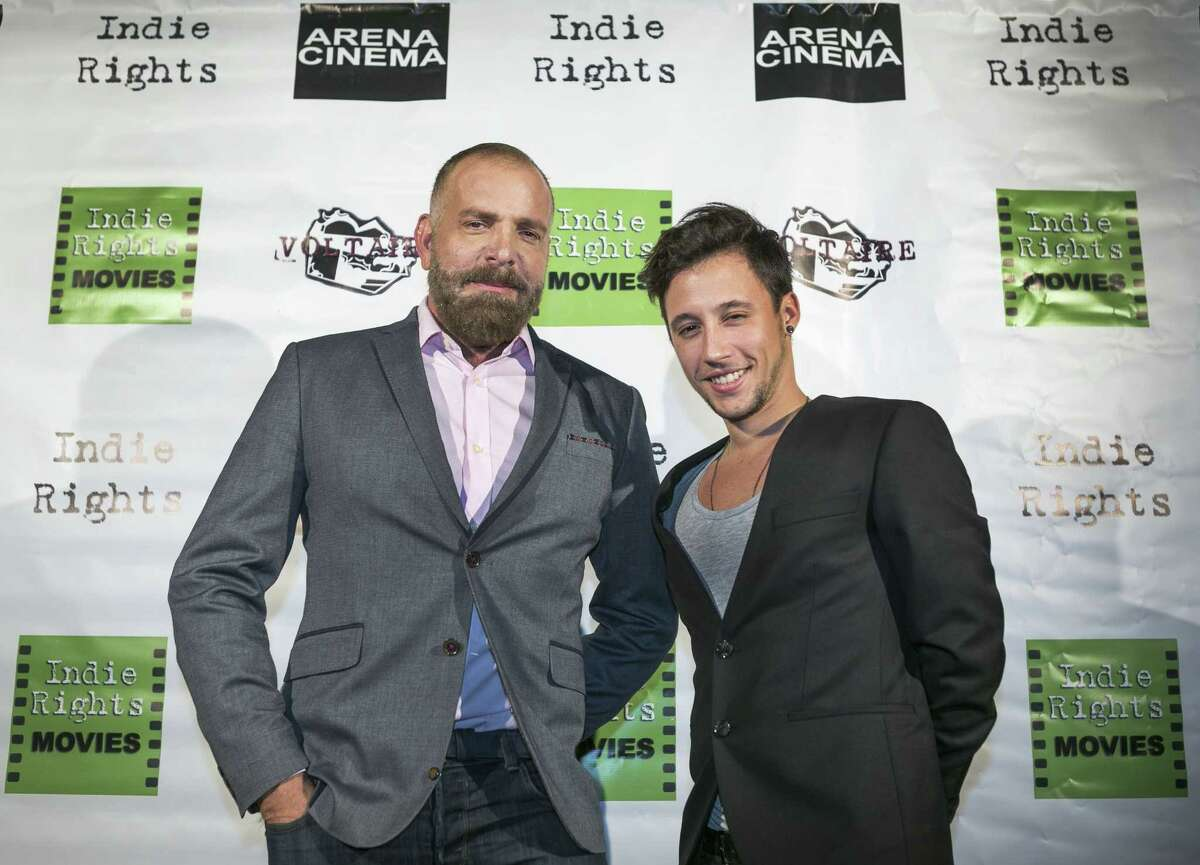 """Rojas, left, and artist Darian Rodriguez Mederos arrive at the opening of """"Alumbrones"""" at the Arena Cinema Hollywood in Los Angeles."""