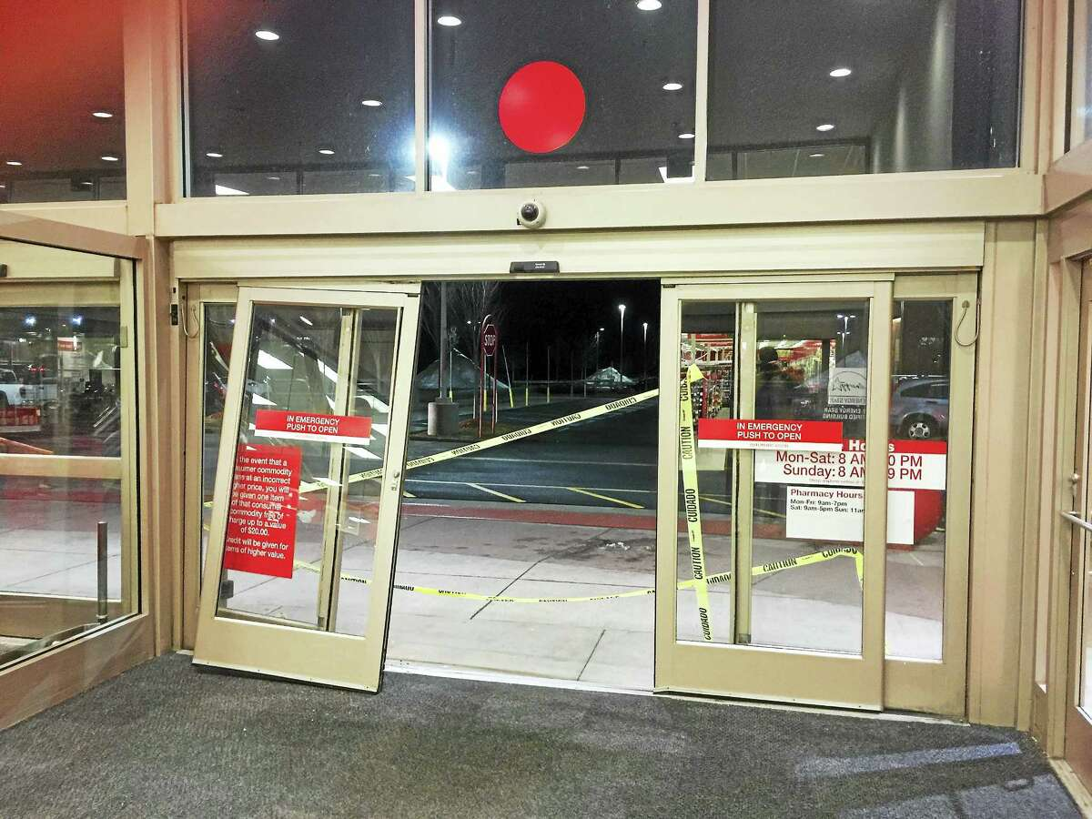 A motorist crashed into the Target on East Main Street Wednesday evening, damaging the store's automatic doors.