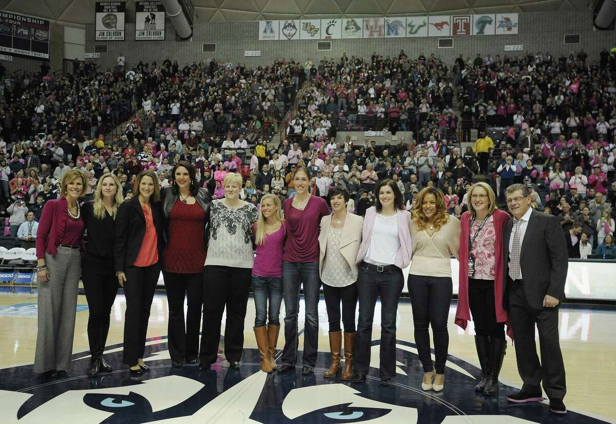 Members of the 1994-95 UConn women's basketball team are honored during halftime of the Huskies' 87-39 win over Tulane on Saturday afternoon at Gampel Pavilion in Storrs.