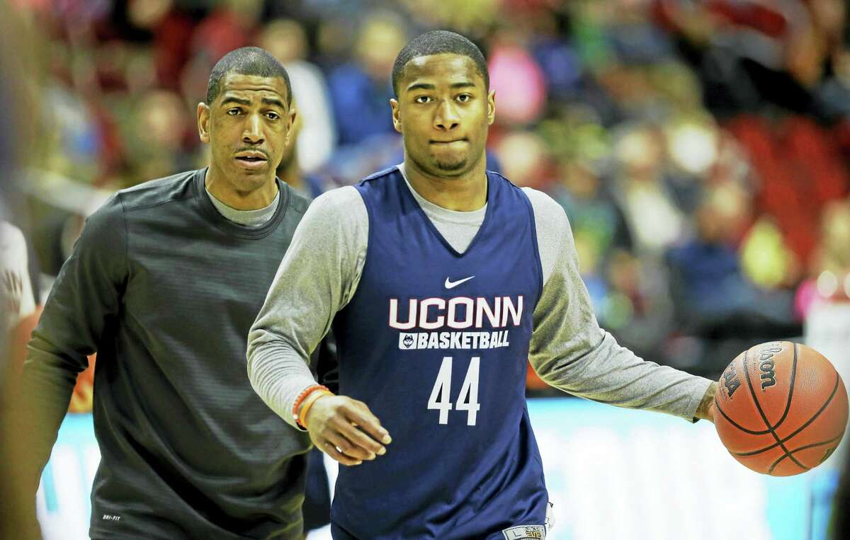 Rodney Purvis, right, coach Kevin Ollie and the UConn men's basketball team takes on New Haven on Sunday in an exhibition game.