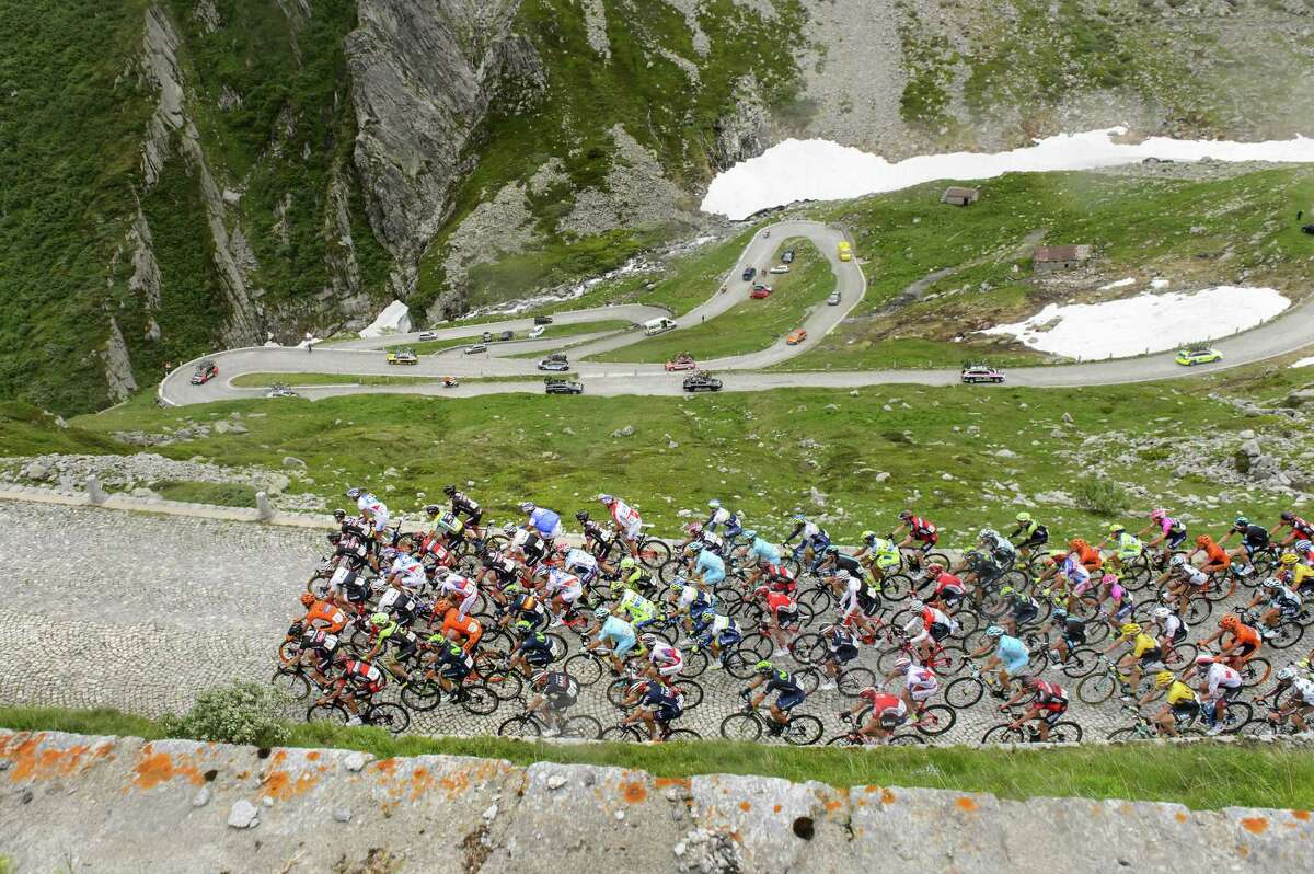 """The pack rides the old """"Tremola"""" road, a cobblestone section, as the riders climb the Gotthard Pass during the 3rd stage, a 117.3 km race, from Quinto to Olivone, at the 79th Tour de Suisse UCI ProTour cycling race, in the Gotthard Pass, Switzerland on June 15, 2015."""