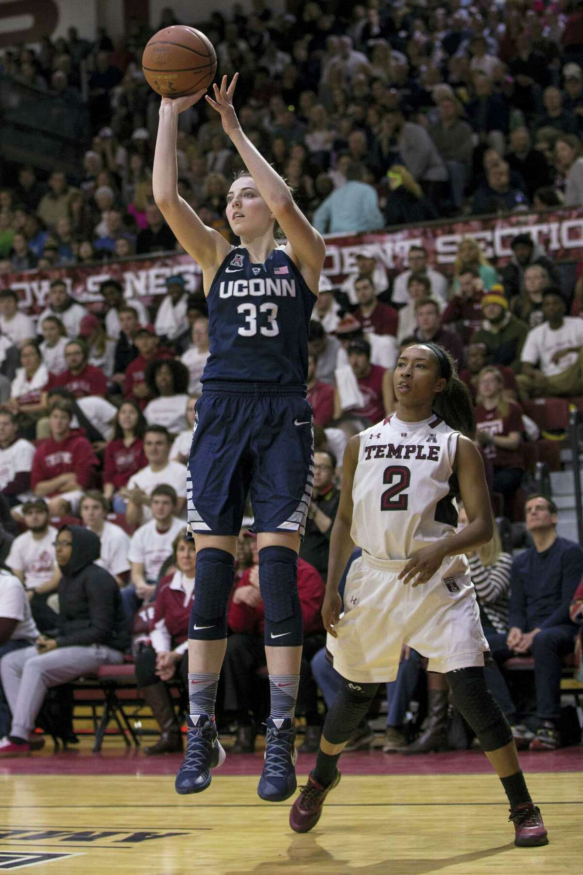 UConn's Katie Lou Samuelson (33), shooting the ball with Temple's Feyonda Fitzgerald (2) looking on during the second half Sunday, knows she can't just sit and watch UConn's seniors if the Huskies are to accomplish their goals.