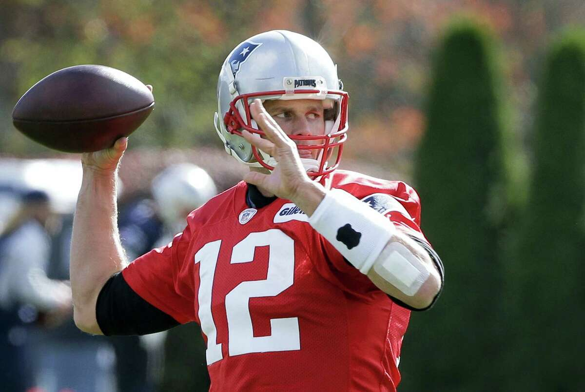 Patriots quarterback Tom Brady (12) winds up for a pass during a recent practice.