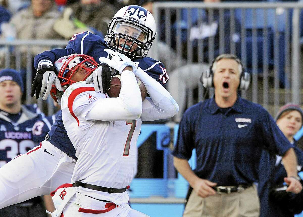 UConn cornerback Ellis Marder (19), seen here defending Rutgers wide receiver Quron Pratt in a 2013 game, is one of three Huskies who are leaving the program.