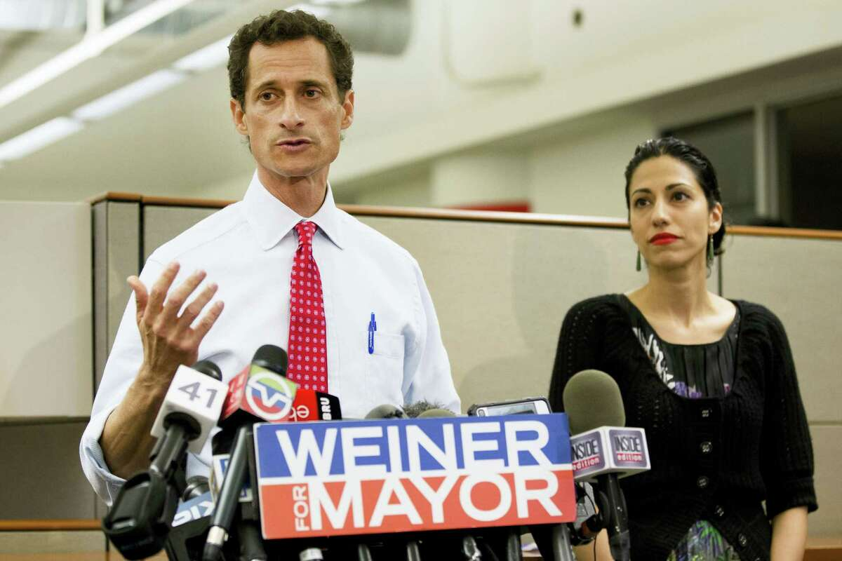 In this July 23, 2013, file photo, then-New York mayoral candidate Anthony Weiner speaks during a news conference alongside his wife Huma Abedin in New York. The FBI informed Congress on Friday, Oct. 28, 2016, it is investigating whether there is classified information in new emails that have emerged in its probe of Hillary Clinton's private server. A U.S. official told The Associated Press the newly discovered emails emerged through the FBI'Äôs separate sexting probe of former congressman Anthony Weiner, the estranged husband of close Clinton confidant Huma Abedin.