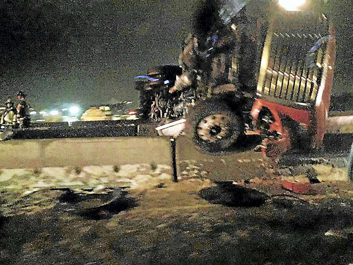 A tractor-trailer rollover shut down northbound Interstate 95 near Exit 44 in West Haven early Tuesday amid icy conditions.