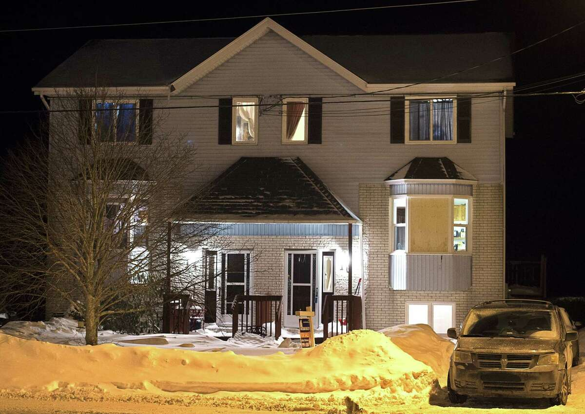 A car is parked outside a home on Tiger Maple Drive in Timberlea, Nova Scotia, a Halifax suburb, where police found a deceased person Friday, Feb. 13, 2015. A senior police official said Friday police foiled a plot by suspects who were planning on going to a mall and killing as many people as they could before killing themselves on Valentine's Day in Halifax. The official told The Associated Press the suspects were on a chat stream and were apparently obsessed with killing and death and had many photos of mass killings. (AP Photo/The Canadian Press, Andrew Vaughan)