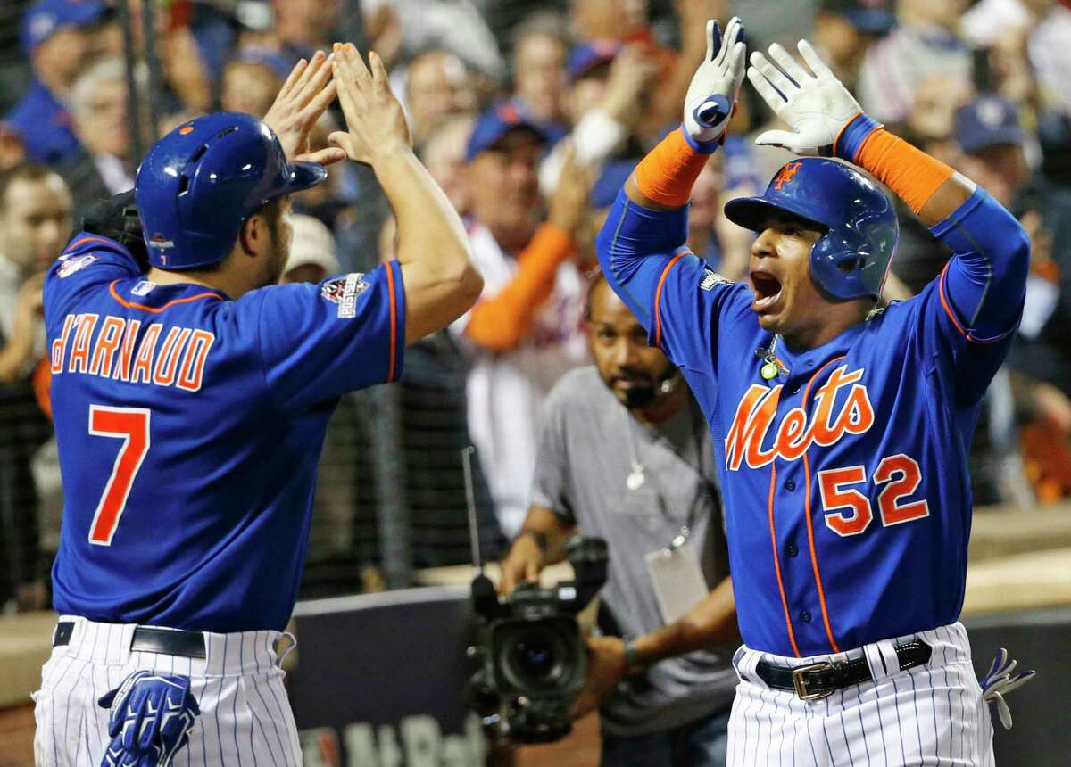 New York Mets' Travis d'Arnaud (7) greets Yoenis Cespedes (52) after Cespedes hit a fourth-inning, three-run home run during baseball's Game 3 of the National League Division Series, Monday, Oct. 12, 2015, in New York. (AP Photo/Kathy Willens)