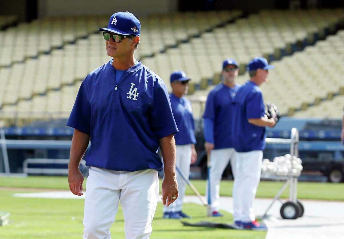 Dodgers manager Don Mattingly walks on the field Oct. 6 in Los Angeles.