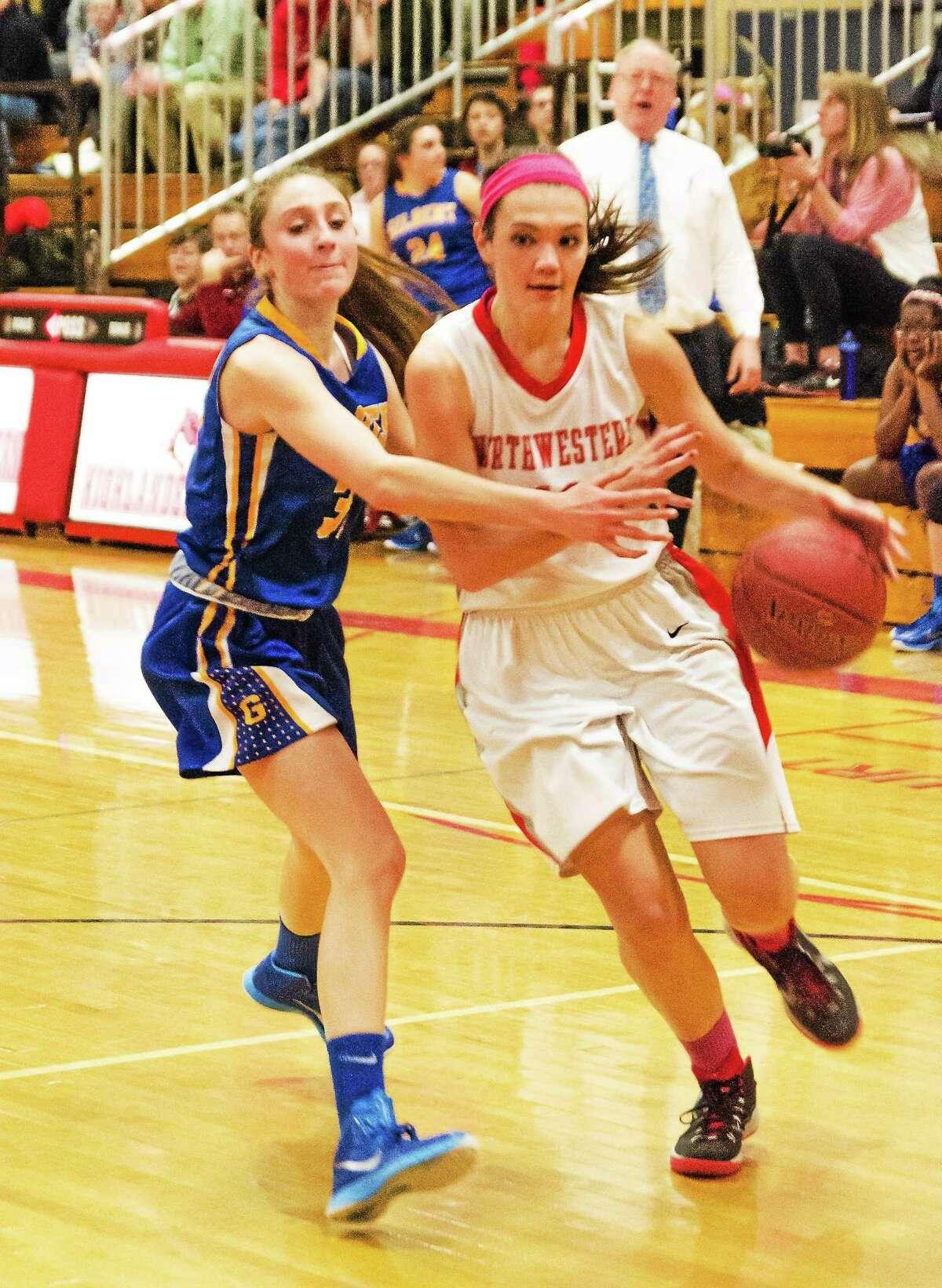 Northwestern's Emma Beltrandi drives to the basket against Gilbert's Ali Brochu Friday night.