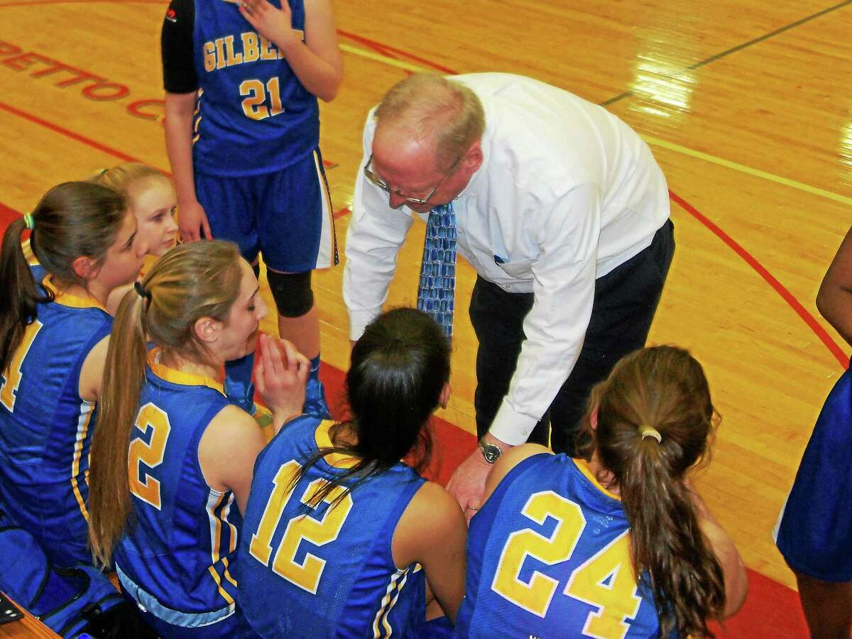 Gilbert coach Gerry Hicks encourages the Yellowjackets during a game against Northwester.