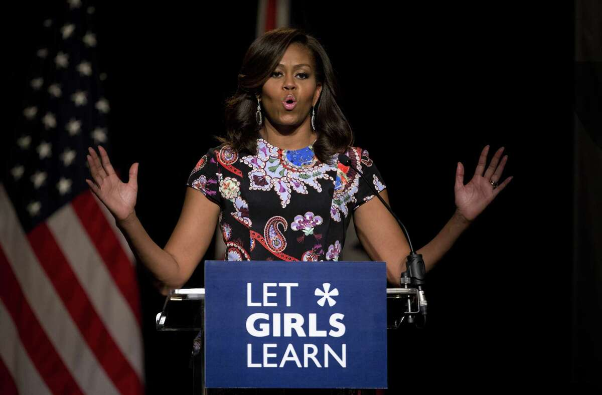 U.S. first lady Michelle Obama addresses students in the main hall of Mulberry School for Girls before taking part in a question and answer session in east London, Tuesday, June 16, 2015. Schoolgirls in east London greeted U.S. first lady Michelle Obama with song, interpretive dance and squeals of joy Tuesday as she traveled to the British capital to promote education for girls. (AP Photo/Matt Dunham)