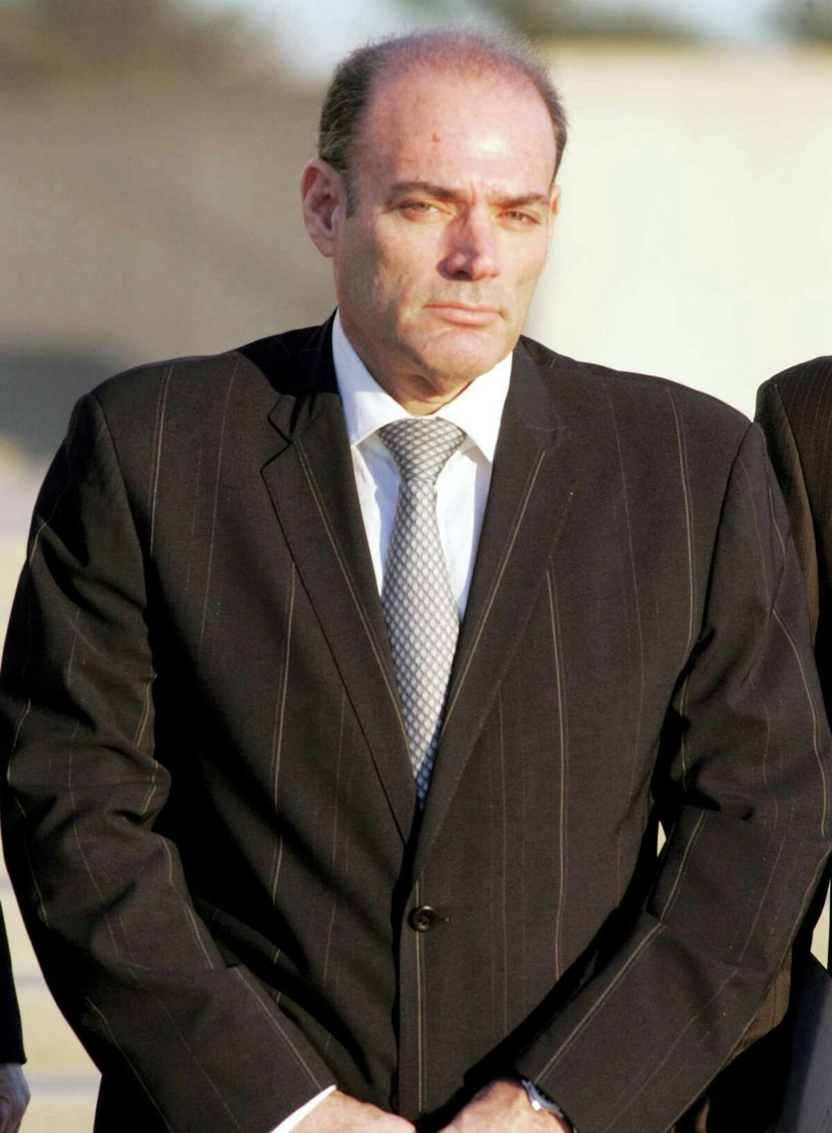 David Brooks leaves the federal courthouse in Central Islip, N.Y. in 2008. Brooks, the founder of America's leading supplier of body armor to the U.S. military, died Thursday in prison while serving a 17-year sentence for running a massive stock fraud scheme. He was 61. Newsday, Howard Schnapp — AP File Photo