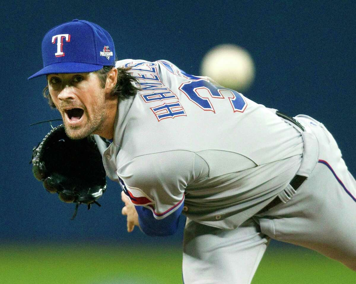 Texas Rangers pitcher Cole Hamels throws against the Blue Jays in the first inning of Game 2 of the American League division series on Friday in Toronto.