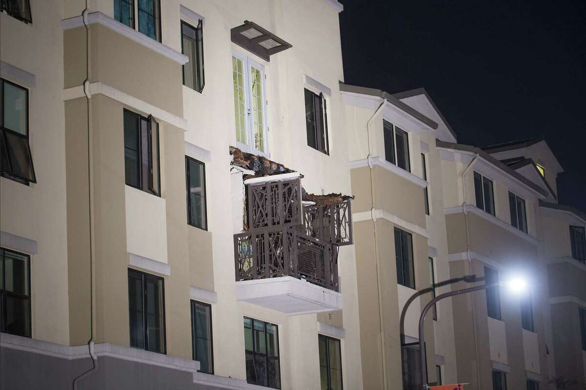 A fourth floor balcony rests on the balcony below after collapsing at the Library Gardens apartment complex in Berkeley, Calif., early Tuesday, June 16, 2015. Berkeley police say several people are dead and others injured after the balcony fell shortly before 1 a.m., near the University of California, Berkeley.