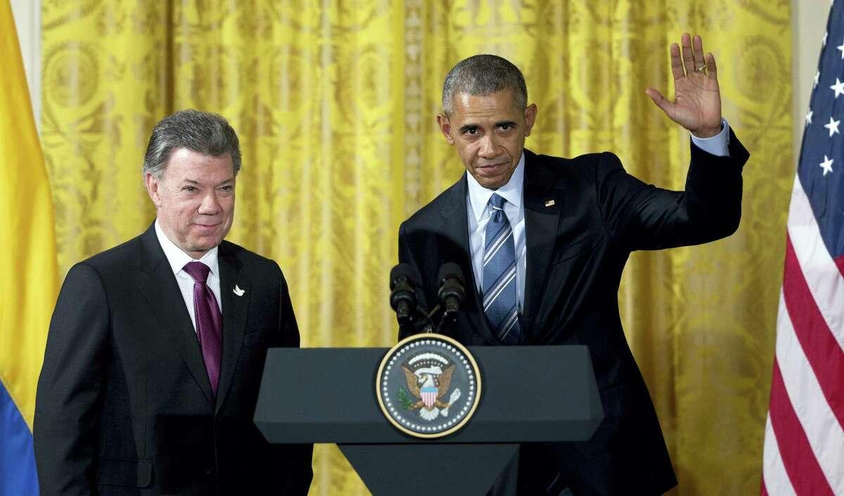 President Barack Obama, right, stands with Colombian President Juan Manuel Santos.