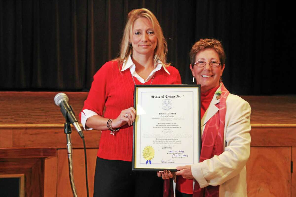 Torrington celebrates Columbus Day Monday by naming Sharon Dante Italian American Mayor of the Day. State Rep. Michelle Cook, D-Torrington, left, presents Dante, right, with a state proclamation.