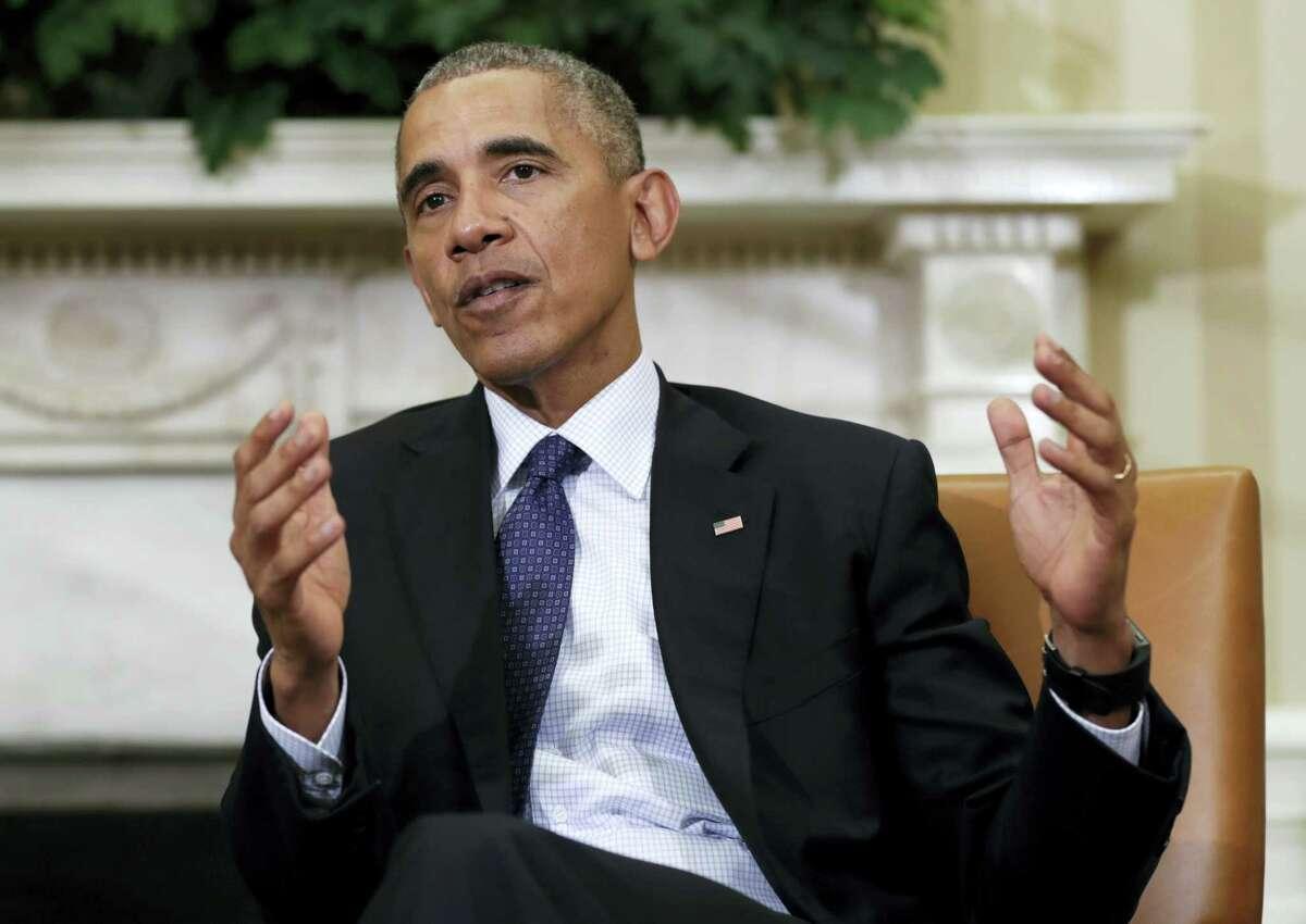 President Barack Obama speaks to media in the Oval Office.