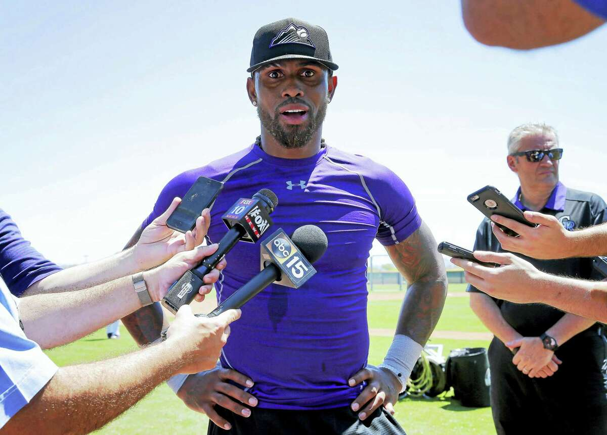 Jose Reyes talks with reporters after an extended spring training workout in May.