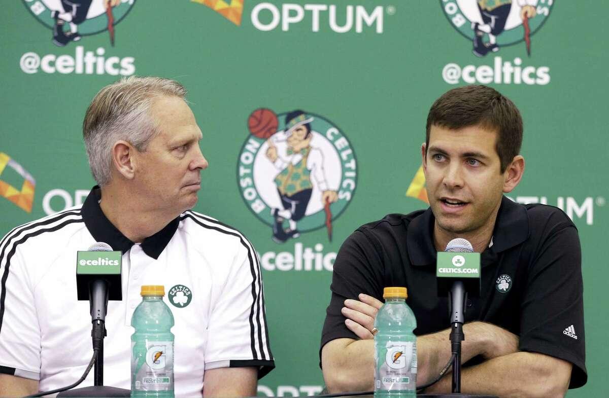 Celtics basketball head coach Brad Stevens, right, speaks as Danny Ainge listens Friday in Waltham, Mass.