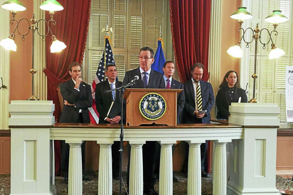 Gov. Dannel P. Malloy speaks during a press conference Tuesday introducing the Connecticut Family Stability Pay for Success project, which aims to assist families dealing with substance abuse. The event was held at the Old State House in Hartford.