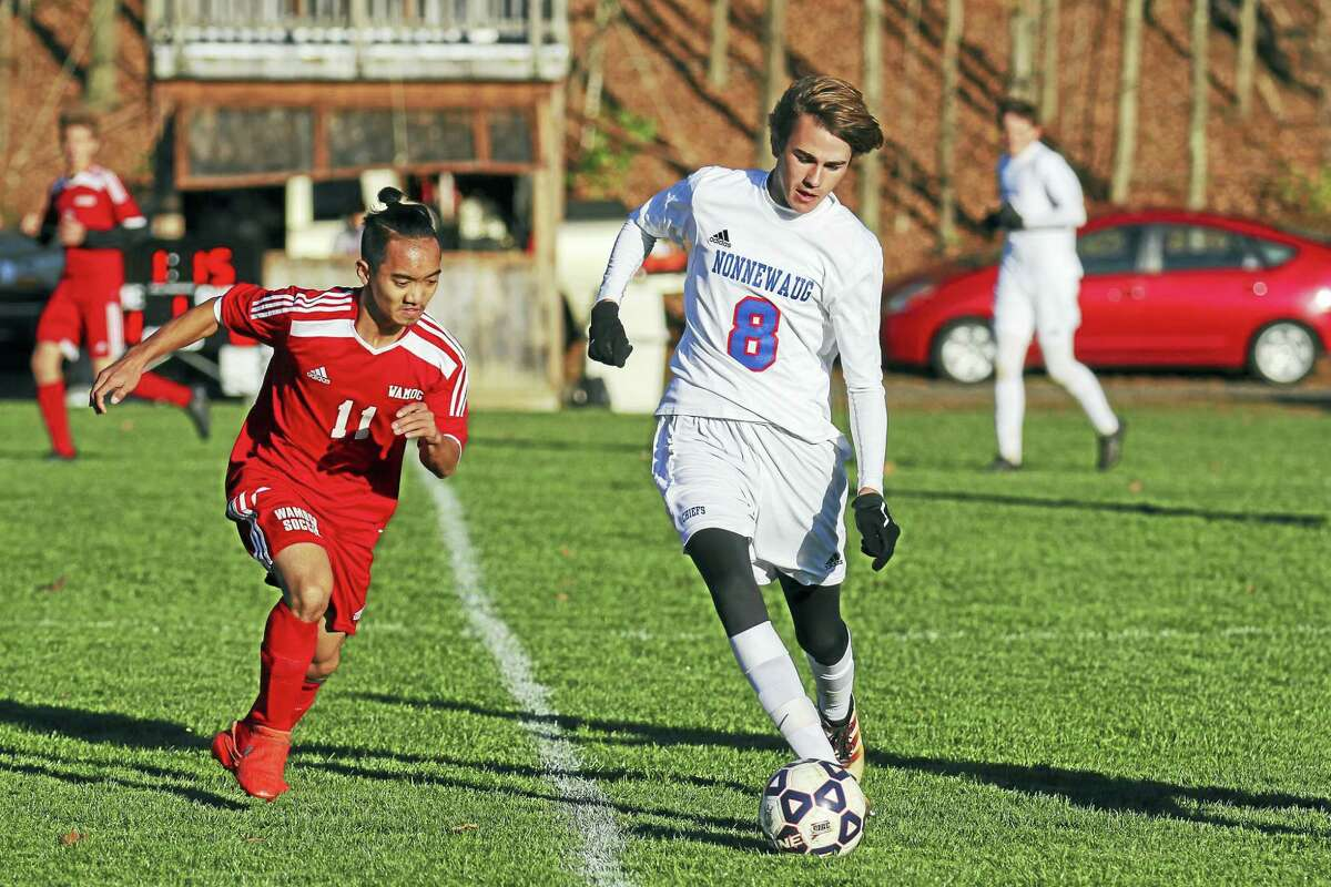 Nonnewaug's Jake Willis, defended by Wamogo's Sam Gabriel-Deveau, scored in the first half of the Chiefs' win.